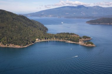 Aerial view of Bowen Island during a sunny summer day. Located in Howe Sound, Northwest of Vancouver, BC, Canada.