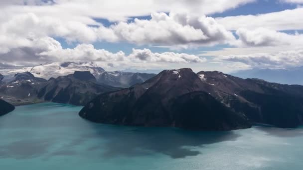 Aerial Timelapse of beautiful Canadian Landscape during a vibrant cloudy summer day. Taken at Garibaldi Lake, near Squamish and Whistler, North of Vancouver, BC, Canada.