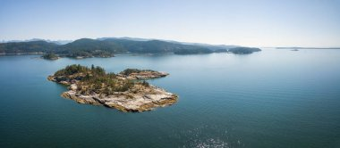 Aerial panoramic view of a rocky island during a vibrant sunny summer day. Taken near Powell River, Sunshine Coast, British Columbia, Canada.
