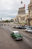 Havana, Cuba - May 23, 2019: Aerial View of an Old Classic American Car in the streets of the Old Havana City during a vibrant and bright sunny day.
