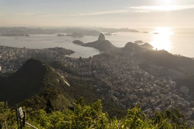 Beautiful landscape with a view to the city and mountains seen from Christ the Redeemer Statue (Cristo Redentor) on top of Corcovado Mountain (Morro do Corcovado) during the sunrise in Rio de Janeiro, Brazil