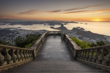 Beautiful landscape with a view to the city, mountains and an empty visitation area seen from Christ the Redeemer Statue (Cristo Redentor) on top of Corcovado Mountain (Morro do Corcovado) during the sunrise in Rio de Janeiro, Brazil