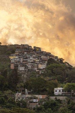 Landscape of Morro dos Prazeres Favela with beautiful sunset clouds on top of a hill, Rio de Janeiro, Brazil