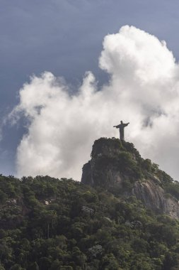 Christ the Redeemer Statue (Cristo Redentor) on top of Corcovado Mountain (Morro do Corcovado) with blue sky and beautiful clouds on the back, Rio de Janeiro, Brazil