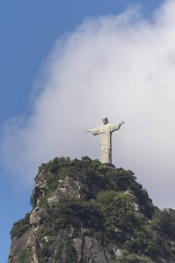 Christ the Redeemer Statue (Cristo Redentor) on top of Corcovado Mountain (Morro do Corcovado) with blue sky and white clouds on the back, Rio de Janeiro, Brazil