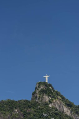 Christ the Redeemer Statue on top of green forested Corcovado Mo