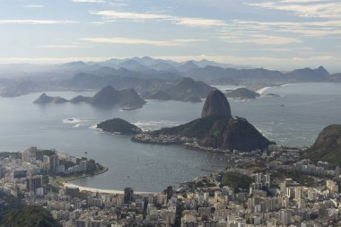 Beautiful view from Corcovado Mountain to Sugar Loaf and city bu