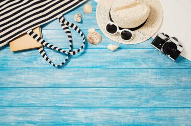 Top view of blue planks marine pier near the beach. Frame composition with summer accessories. Background with copy space and visible wood texture. Border composition stock vector