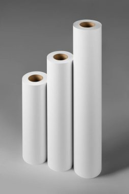 Blank white paper rolls isolated on gray background. Mockup paper for magazines, catalogs or newspapers isolated on gray backdrop, Printing house theme or wrapping paper for presents stock vector