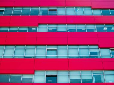 Red modern office building with few one windows