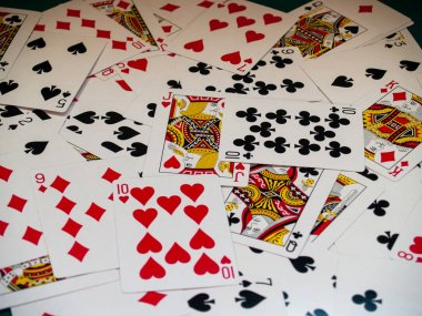 A deck of poker cards on a green rug