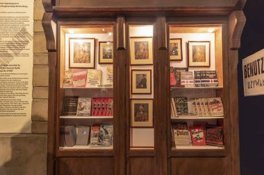 Krakow, Poland - June 3, 2018: Library furniture with books and other nazi goods in Oskar Schindler's Enamel factory museum