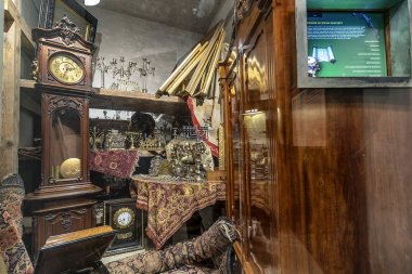 Krakow, Poland - June 3, 2018: Some confiscated Jewish belongings in the German occupation of Poland in the ww2 in Oskar Schindler's Enamel factory museum