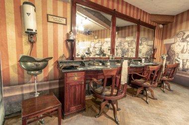 Krakow, Poland - June 3, 2018: Vintage Barber shop furniture used in german-occupied Poland. Inside Oskar Schindler's Enamel factory museum