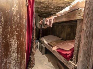 Krakow, Poland - June 3, 2018: Original jewish workers bedroom in Oskar Schindler factory. Inside Oskar Schindler's Enamel factory museum
