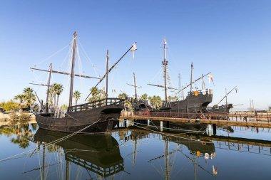 Santa Maria, Nina and Pinta caravels of Christopher Columbus, moored in port of Palos de la Frontera village, Huelva, Spain