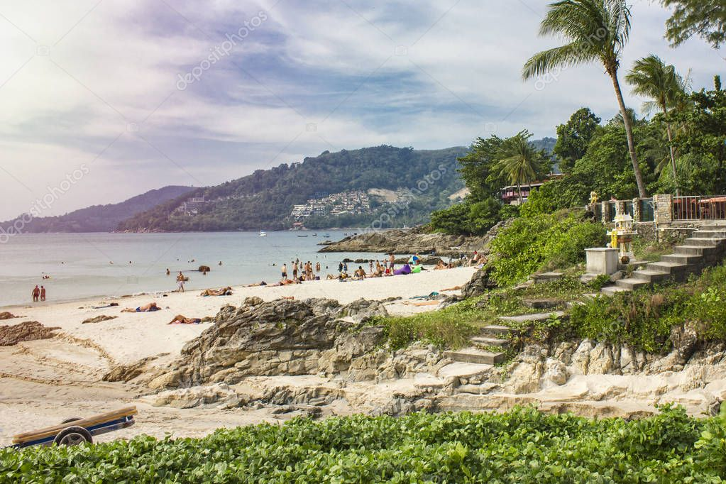 PHUKET, THAILAND January 20, 2018 - People are resting on a clean beach, overlooking the mountains