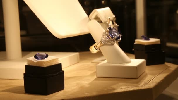 Big ring with purple stone in a glass case in jewelry store