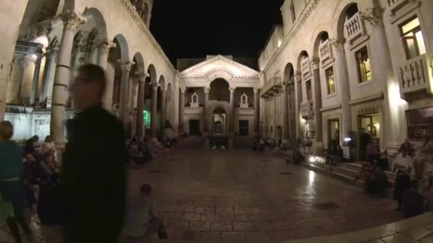 Tourists sightseeing Diocletian's Palace and Cathedral of Saint Domnius at night Split, Croatia October 20, 2017