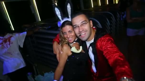 2 in 1 young and old Hugh Hefner with Playboy bunnys, Happy Halloween.People in costumes dance at Halloween party in club October 31, 2016, New York, USA