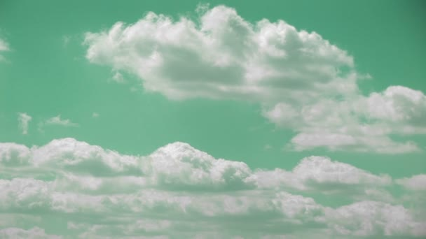 turquoise sky with white clouds