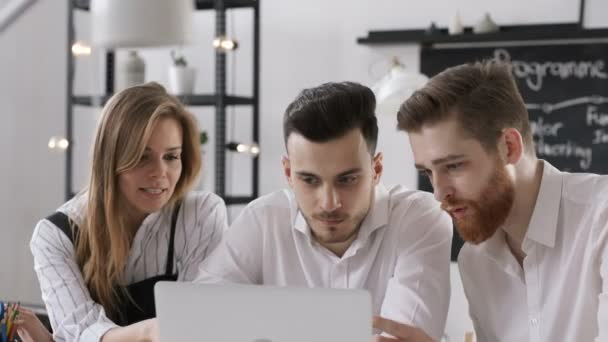 Three beautiful trendy persons start up financial solution in bright boardroom or loft space. Busy male caucasian hipster woman sitting at table. Sharing confident collaboration. Coworking report idea