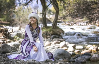 LAKE ISSYK-KUL, KYRGYZSTAN - SEPTEMBER 6, 2018: young kyrgyz woman in wood