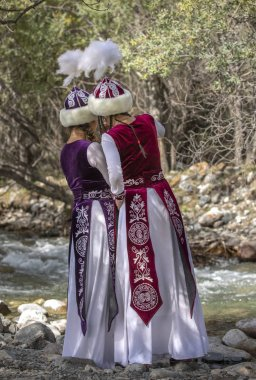 LAKE ISSYK-KUL, KYRGYZSTAN - SEPTEMBER 6, 2018: young kyrgyz women in wood