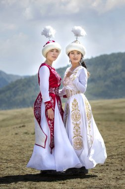 LAKE ISSYK-KUL, KYRGYZSTAN - September 6TH, 2018: Young Kyrgyz ladies on nature background