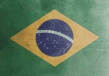 Flag of Brazil metal background close up .