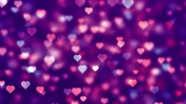 szerelem szív villogó romantikus Spinning lógó izzó szerelem kőr színű részecskék mozgó hurok háttér a Valentin-nap, anyák napja, születésnap, esküvő, évforduló, meghívás üdvözlés.