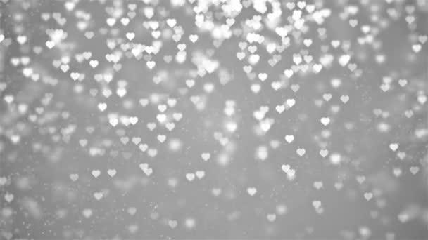 bianco fino a giù romantici filatura penzoloni incandescente amore cuori colorati particelle Background Loop in movimento per giorno di San Valentino, festa della mamma, compleanno, matrimonio, anniversario, invito