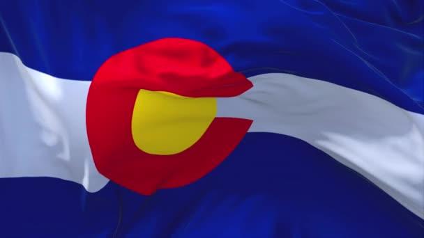 267. Colorado státní vlajka mávala vítr sekvencích bezešvé pozadí