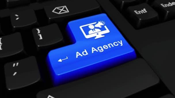 77. reklamní agentura kruhovým pohybem na tlačítko klávesnice počítače