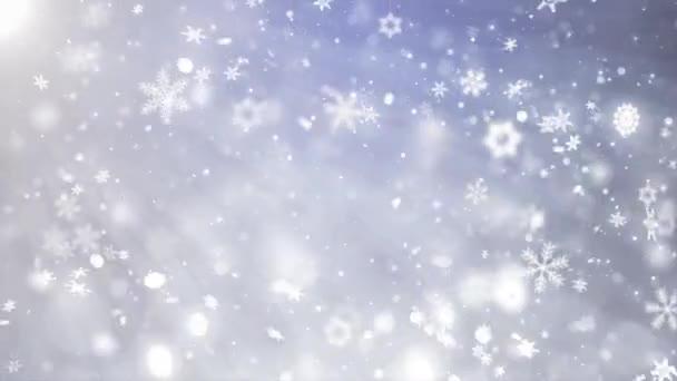 Cadendo giù bianco blu liscio movimento lento dei fiocchi di neve effetto movimento
