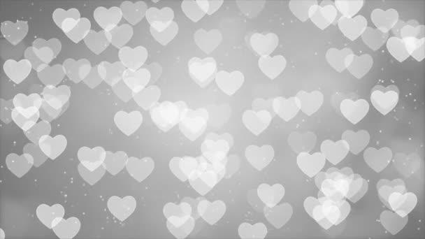 Foukání a mizí malá bílá srdce tekoucí na pozadí bílé smyčky