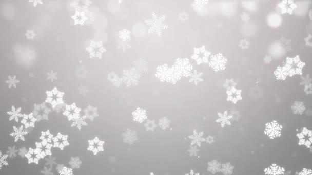 Padající bílé konfety, sněhové vločky a bokeh světla na zlaté smyčky vánoční pozadí.