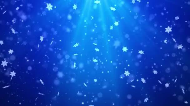 Modré bokeh třpyt, Částice vločky sníh a lesk světla vánoční smyčka pozadí