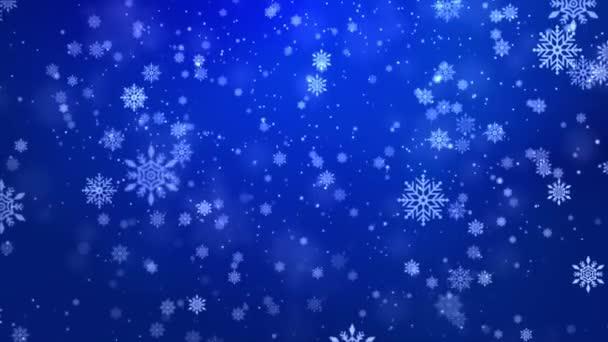 Modré vločky se vznášejí ve vzduchu. Sněhové vločky, sněhová smyčka pozadí.