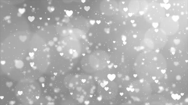 Bílé zářící srdce částice bokeh abstraktní pohyb 4K smyčka animace pozadí.