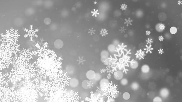 Sníh padající na modré obloze s bílými částicemi v zimě vánoční smyčka pozadí