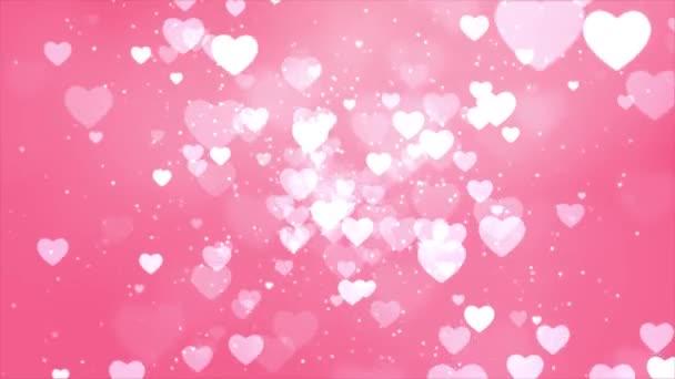 Růžové zářící srdce částice bokeh abstraktní pohyb 4K smyčka animace pozadí.