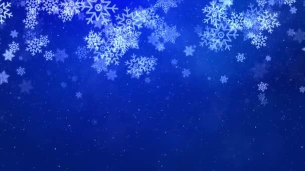 Animált havazó részecskék esik szépen egy kék téli karácsonyi háttér