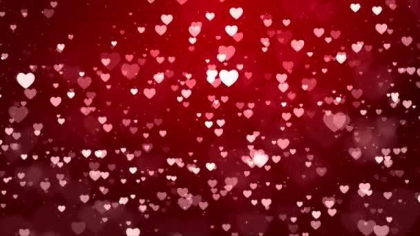Foukání a mizí malé červené Srdce tekoucí na pozadí bílé smyčky