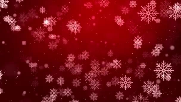 Ve vzduchu létají červené vločky. Sněhové vločky, sněhová smyčka pozadí.