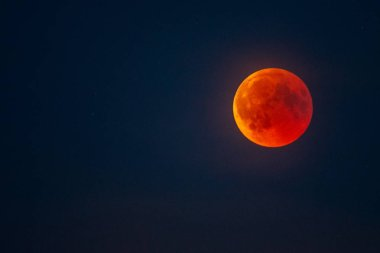 Bloody moon on dark sky background