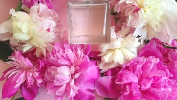 bottle of perfume flower peony slow motion