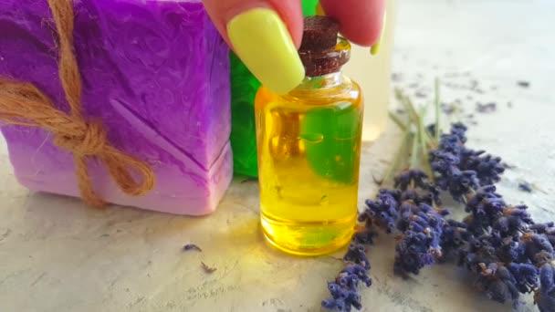 soap lavender oil female hand slow motion on gray concrete