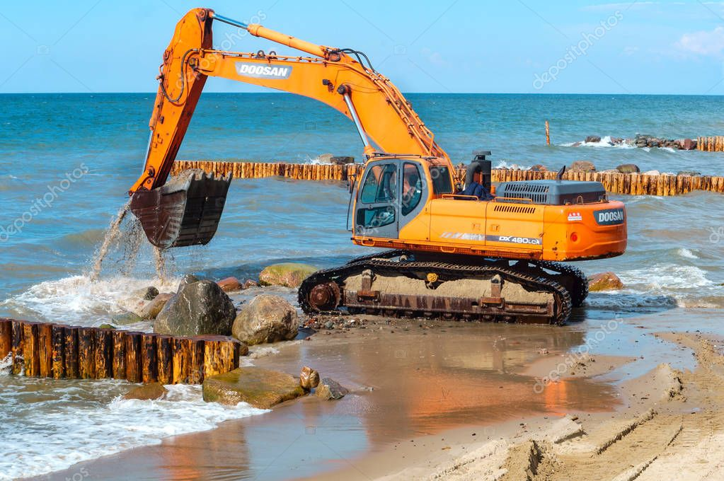 construction of breakwaters, construction equipment on the sea coast