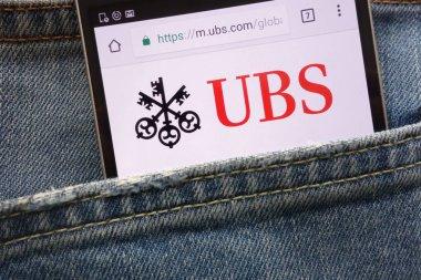 KONSKIE, POLAND - MAY 19, 2018: UBS website displayed on smartphone hidden in jeans pocket